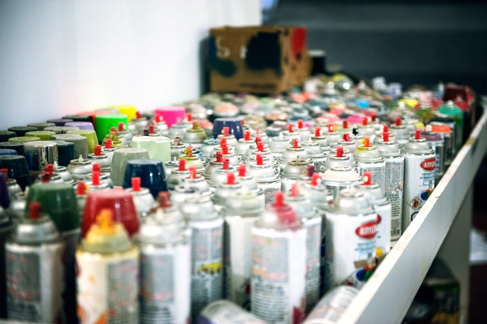 The many spray cans of crazy colour Denial uses to make his masterpieces.