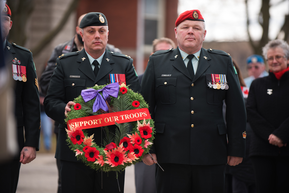 Soldiers presenting a wreath to lay at the Cenotaph.