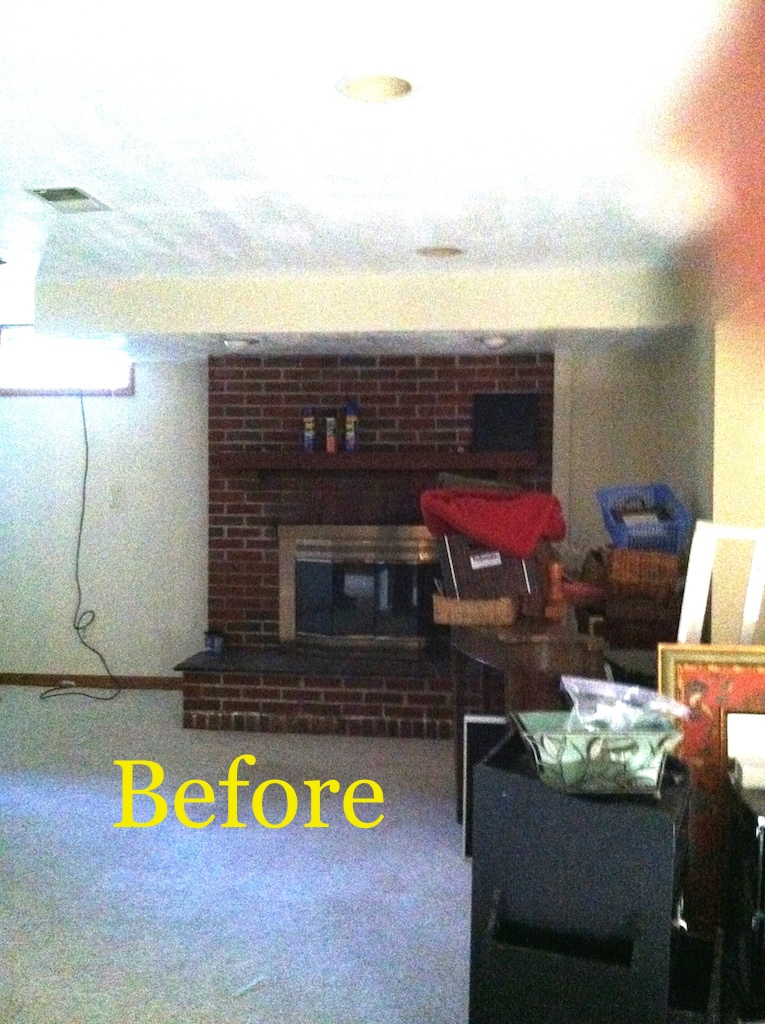 Rexford basement fireplace before.JPG