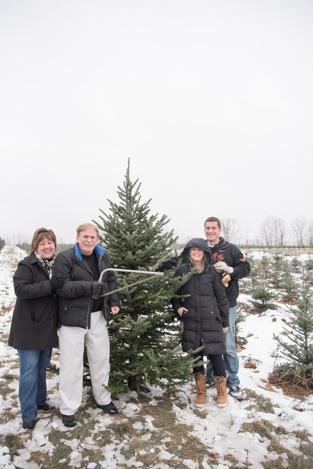 Cutting down the family christmas tree... don't let Dave fool you - Jordan did all the work!