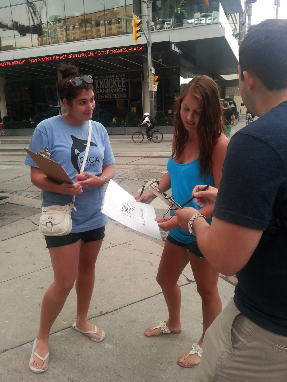 Some O.U. members providing more information on Orca captivity and how to help out locally.