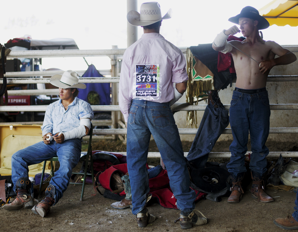Bareback Bronc riders wrap elbows before their runs on the final day of the National Little Britches Rodeo Saturday, July 27 2013 at the Pueblo State Fairgrounds.