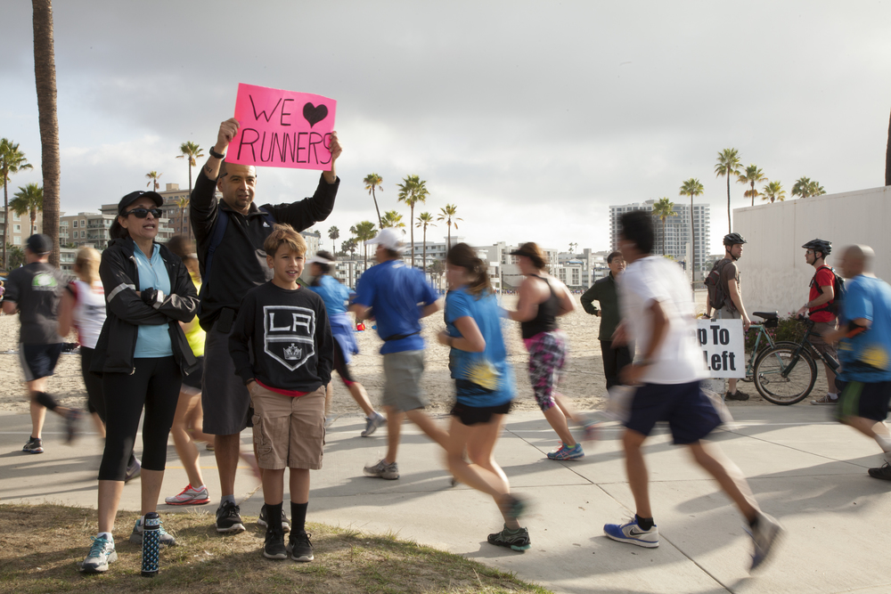 A family cheers on the Long Beach Marathon and Half Marathon runners.
