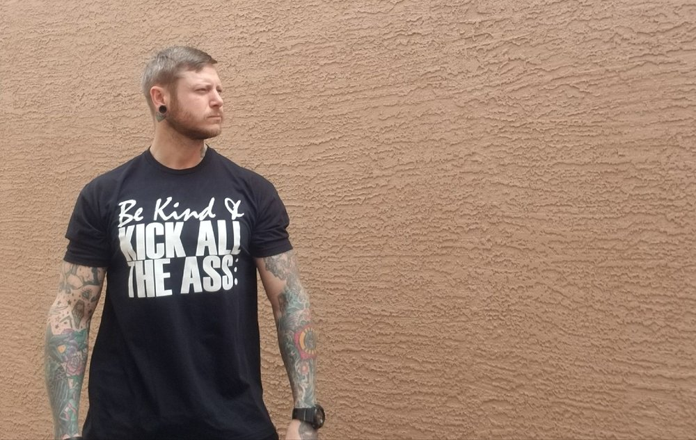 Casey Q of Lift N' Let Die sporting the New Joshua Coburn Be Kind Tee!