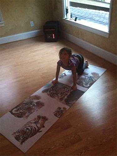 "Lo on her custom ""Tiger"" mat"