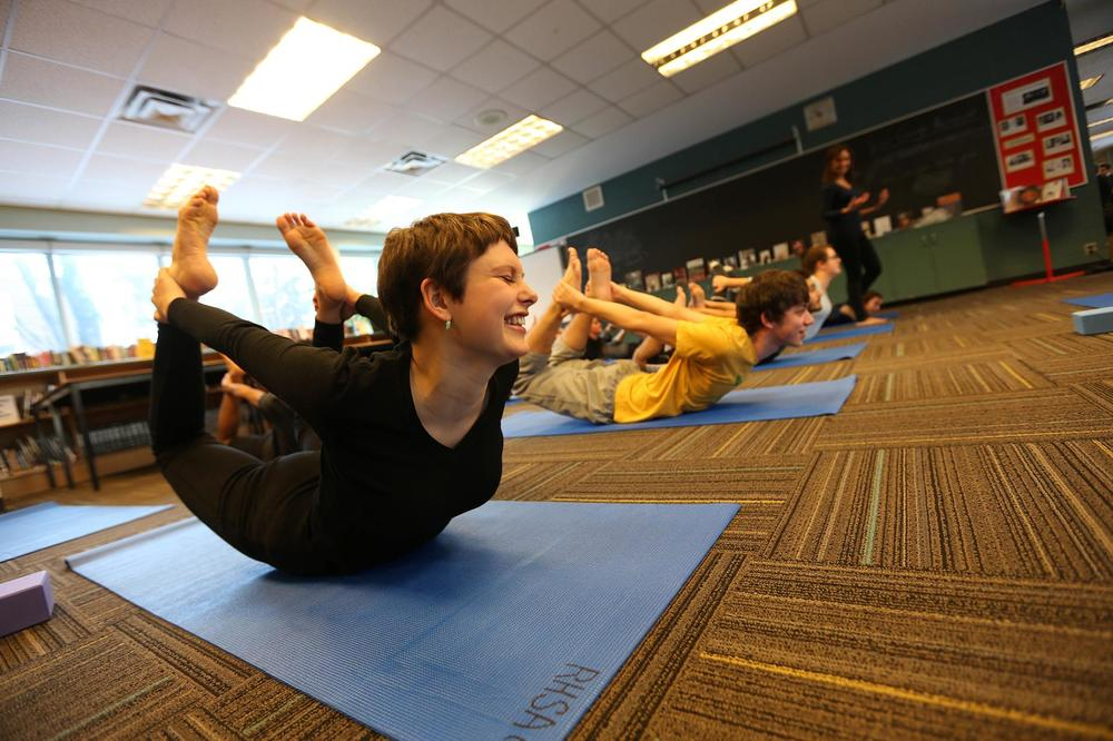 Yoga practitioners, like these students in the bow posture, could experience reduced stress and better sleep.  PHOTOGRAPH BY RENE JOHNSTON, GETTY IMAGES