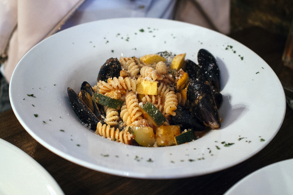 Fusilli with mussels, zucchini, in light tomato sauce