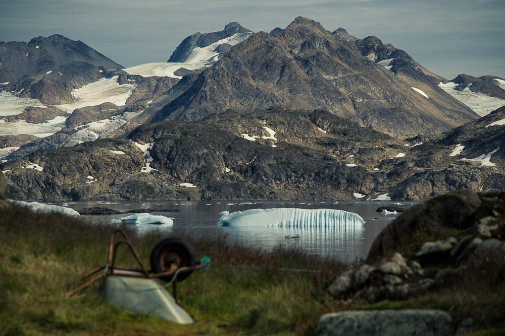 A wheelbarrow and an iceberg. Kulusuk, Greenland.