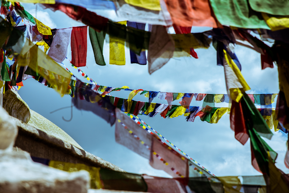 Prayer flags strung across the enormous Boudhanath Stupa, Kathmandu. The largest stupa in Nepal, an ode to the enlightened mind of the Buddha.