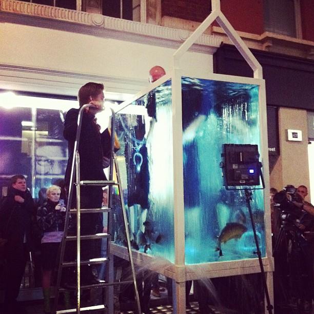 Oleg Kulik baptizing some fish (Taken with  Instagram  at Regina Gallery)