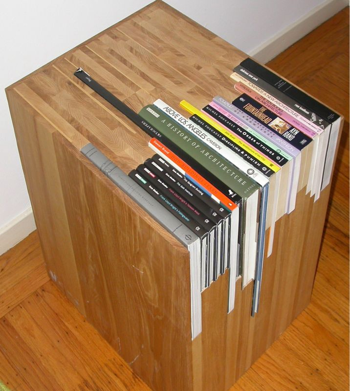 bookshelfporn :     Custom Stacked Book Side Table available on  Etsy for $1800 .   (via  Quipsologies )     WANT.