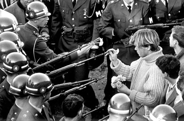 "ourtropes :      vladislava :      babyastronauts :      splitpeavintageblog      "" The people in power will not disappear voluntarily, giving flowers to the cops just isn't going to work. This thinking is fostered by the establishment; they like nothing better than love & nonviolence. The only way I like to see cops given flowers is in a flower pot from a high window. ""   — William S. Burroughs     Ward Churchill,   Pacifism as Pathology   (or, here's a direct link to a formated  .pdf )"