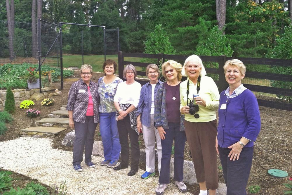 [Newcomers Club members at garden of Nancy Watkins]