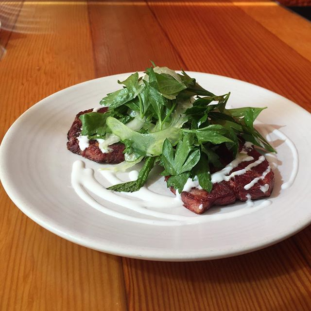 On the menu tonight, corned beef tongue a la plancha - house creme fraiche, celery-herb salad #tapas #bocadillossf #beeftongue #lengua