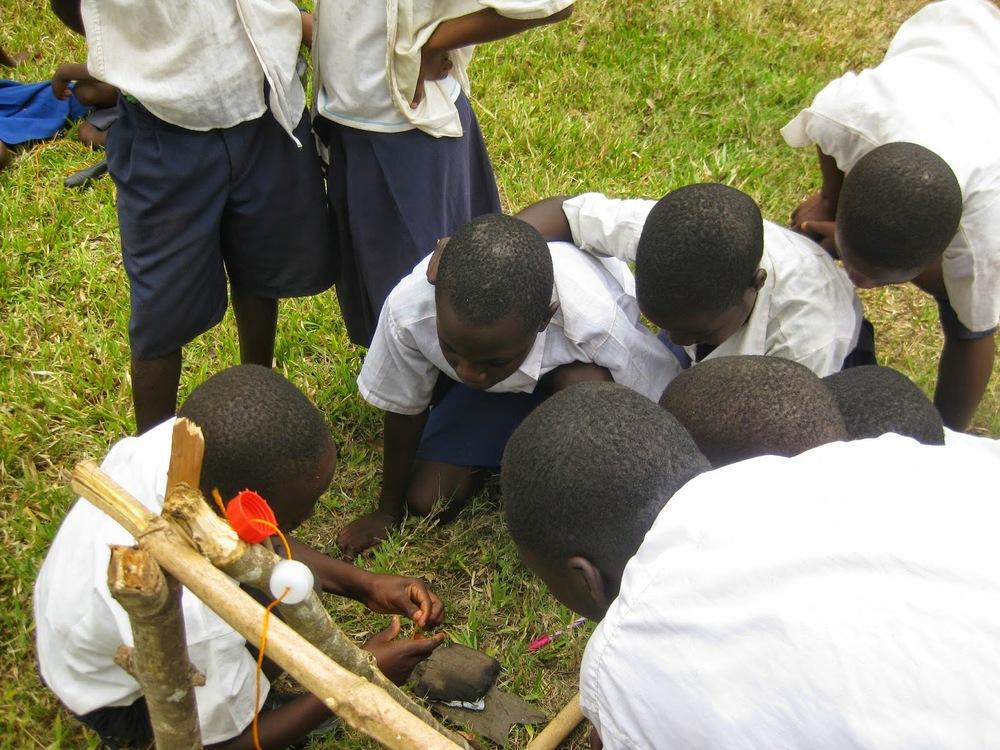 School children making tippy tap