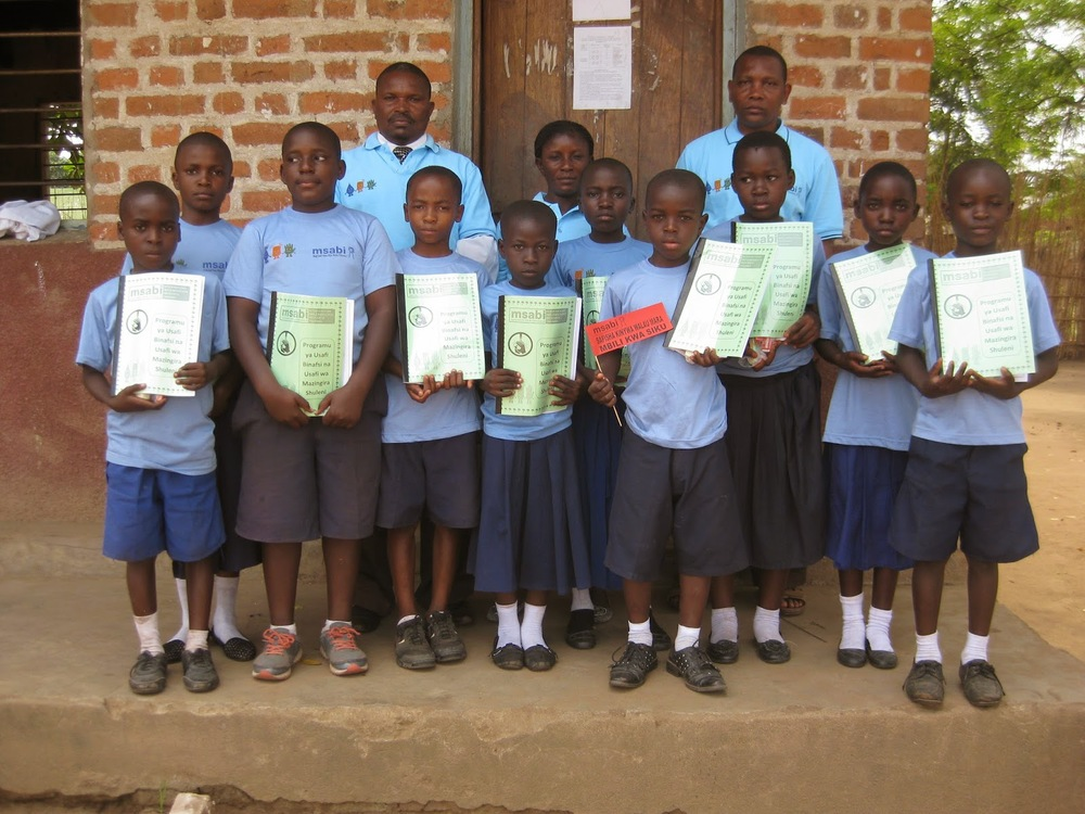 SWASHE members with their teachers at Malinyi primary school