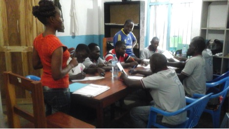 Grace Melau conducting theoretical drilling training session in the MSABI office