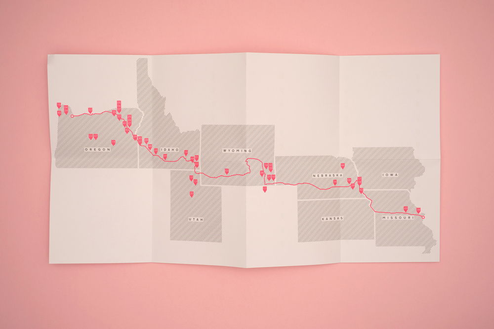 A Pink Flamingo, Jack Latham photobook. Photos taken across America following the Oregon trail. Unfolded map showing photo locations across America. Printed in grey and neon pink.