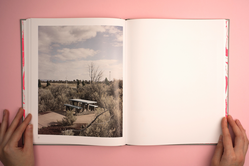 A Pink Flamingo, Jack Latham photobook. Photos taken across America following the Oregon trail. Photograph of a bench in a lay by.