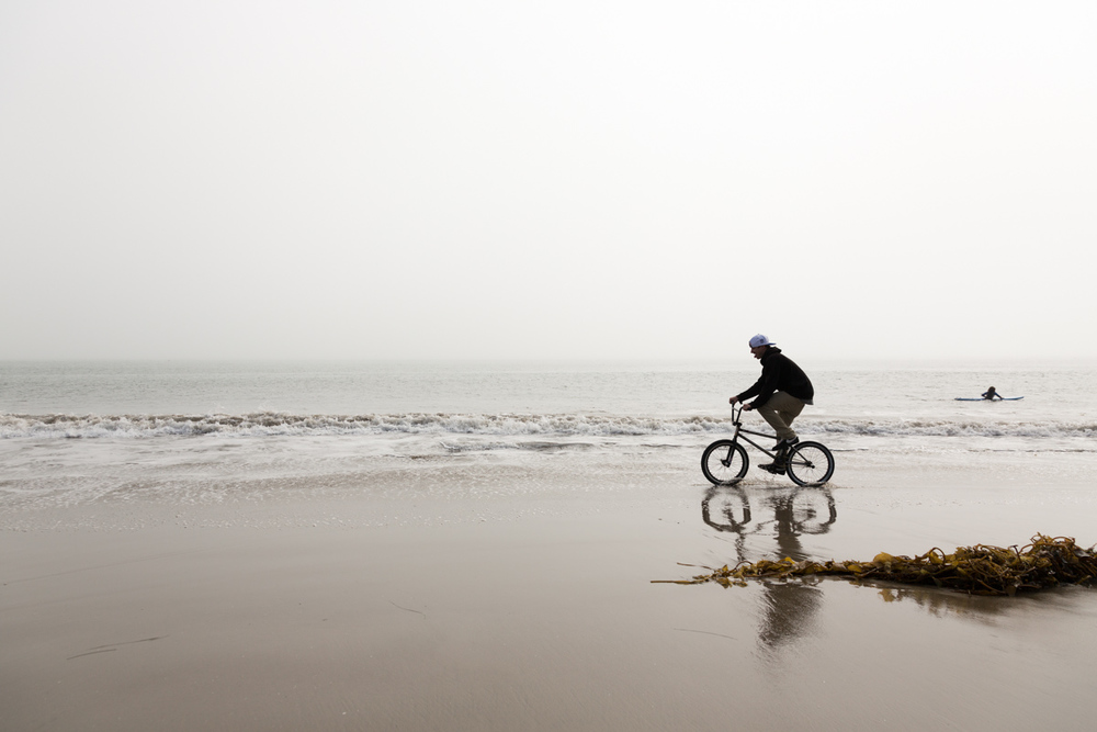 Jeff Cadger riding along the beach on a misty morning.