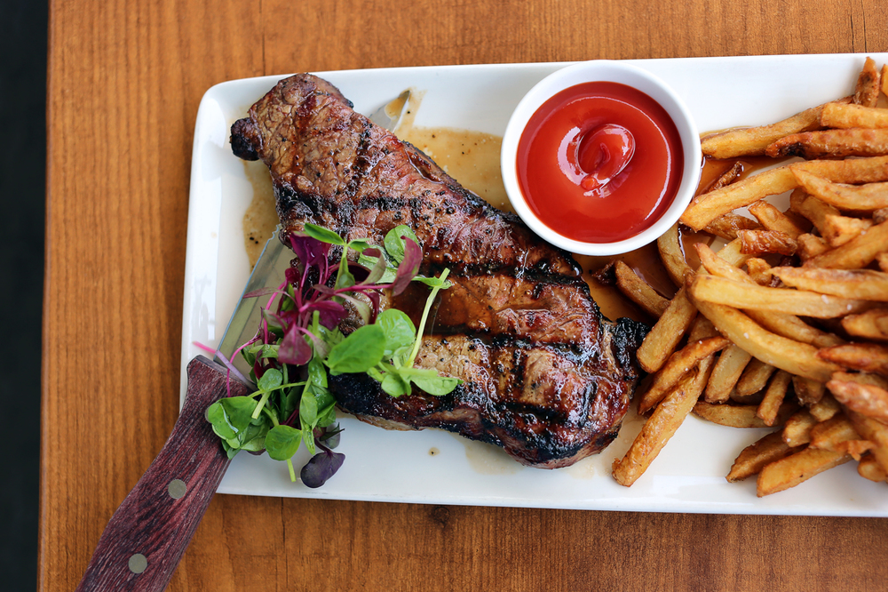 Tavern Steak   - Grilled 8oz striploin steak topped with demi-glace, served with fresh hand cut Yukon Gold fries