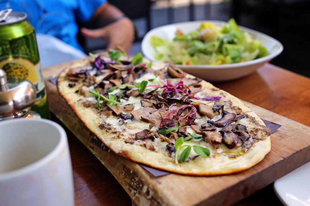 Mushroom Flatbread -   Truffle cream, enoki and king mushrooms, and Fontina cheeses and truffle oil