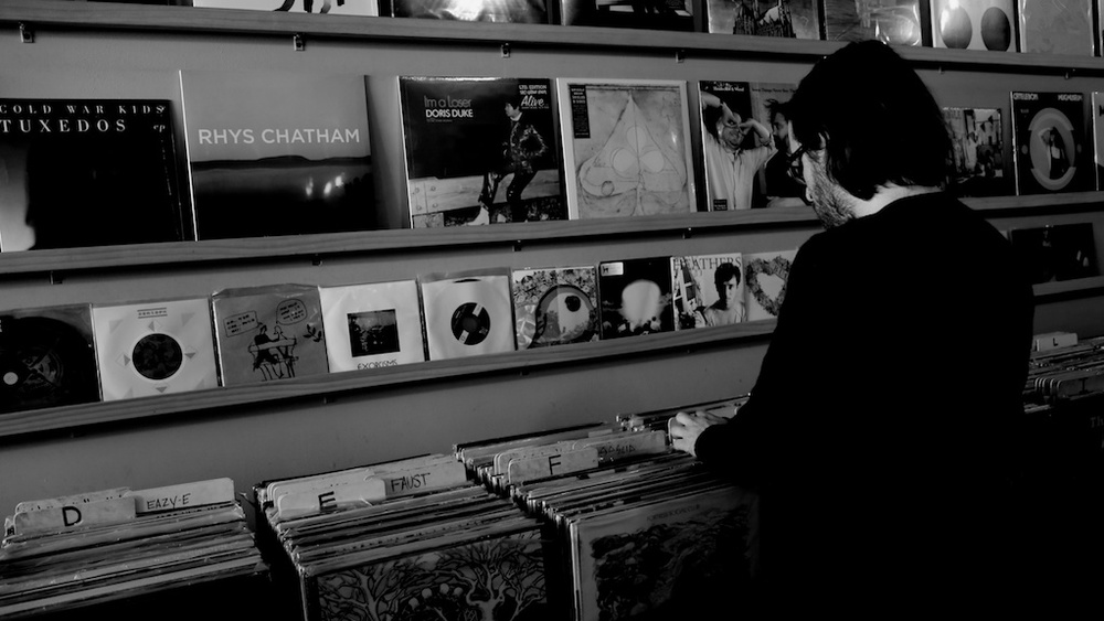 A vinyl lover, checking out the albums.