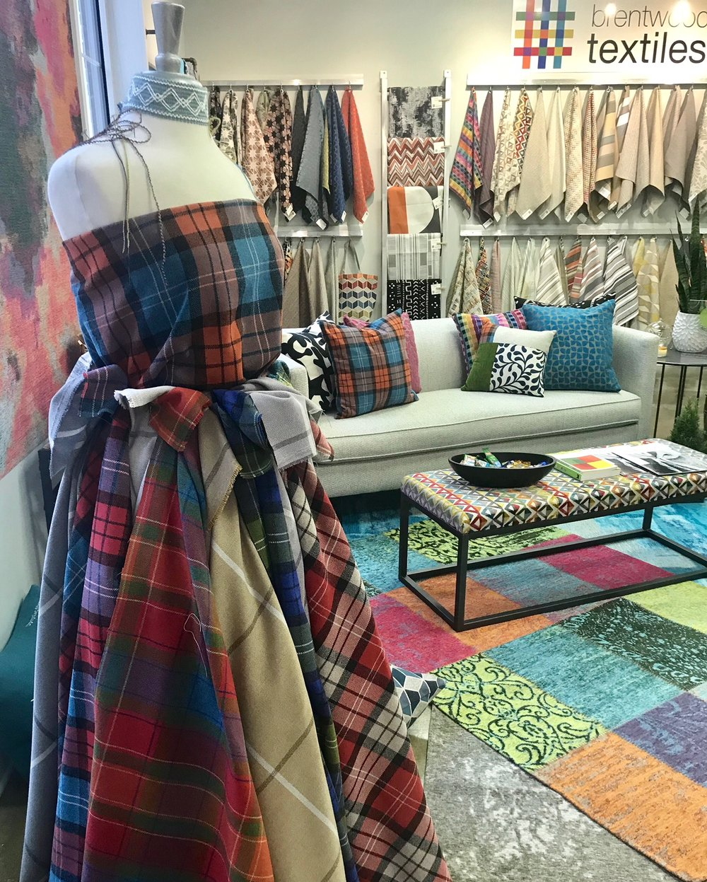 Layered, patchwork floor cloths in the Brentwood show room in High Point, NC