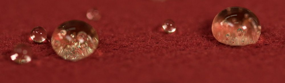 Above: An example of how water beads on a fabric that is coated in PFC chemicals.