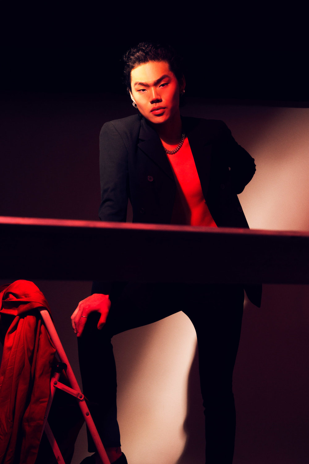 Portrait of an asian model in red light.