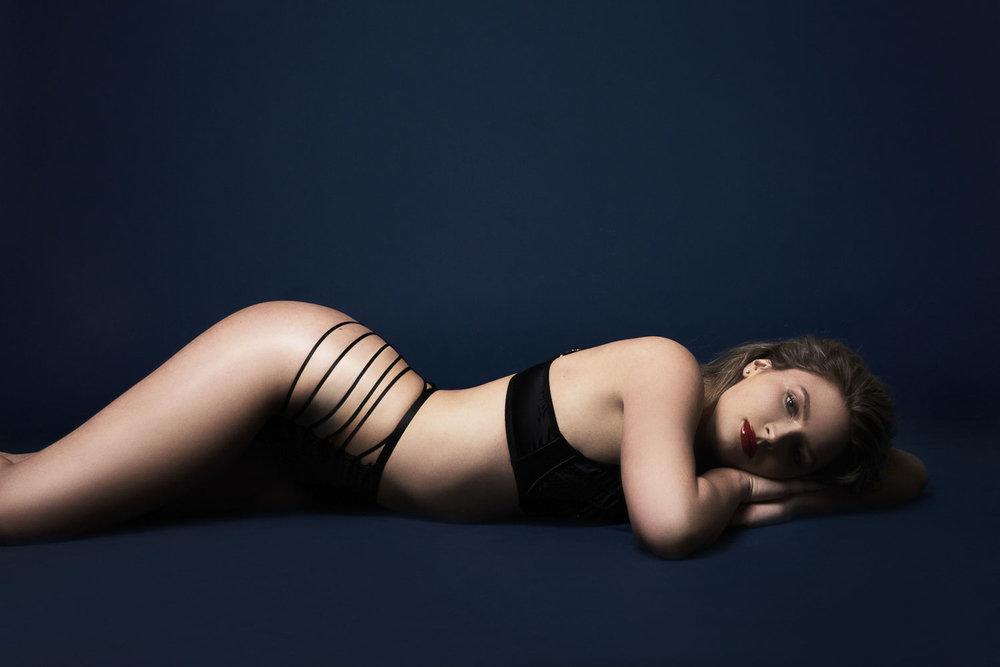 Woman in black Agent Provocateur lingerie