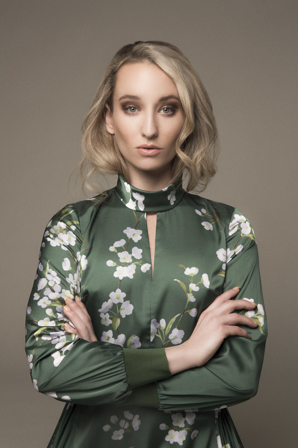 Model in a green Ted Baker dress