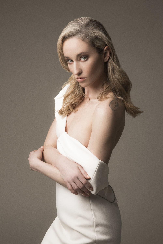 Blonde model in white Ted Baker London pencil dress