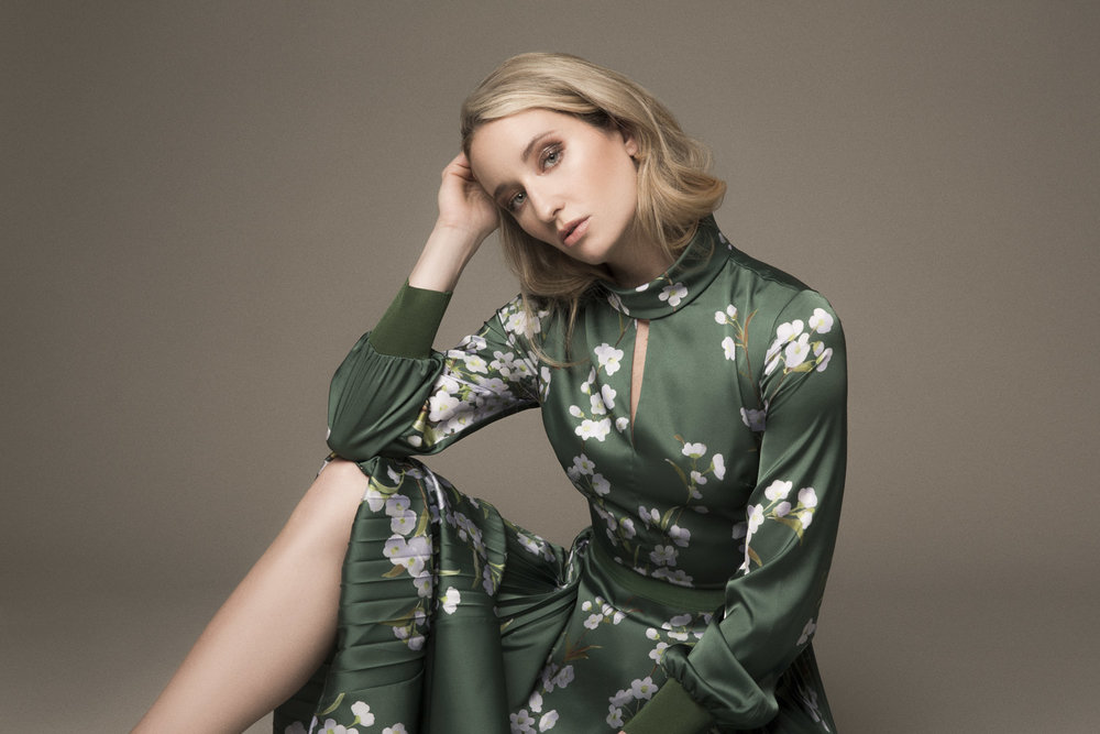 Woman sitting in a green silk dress