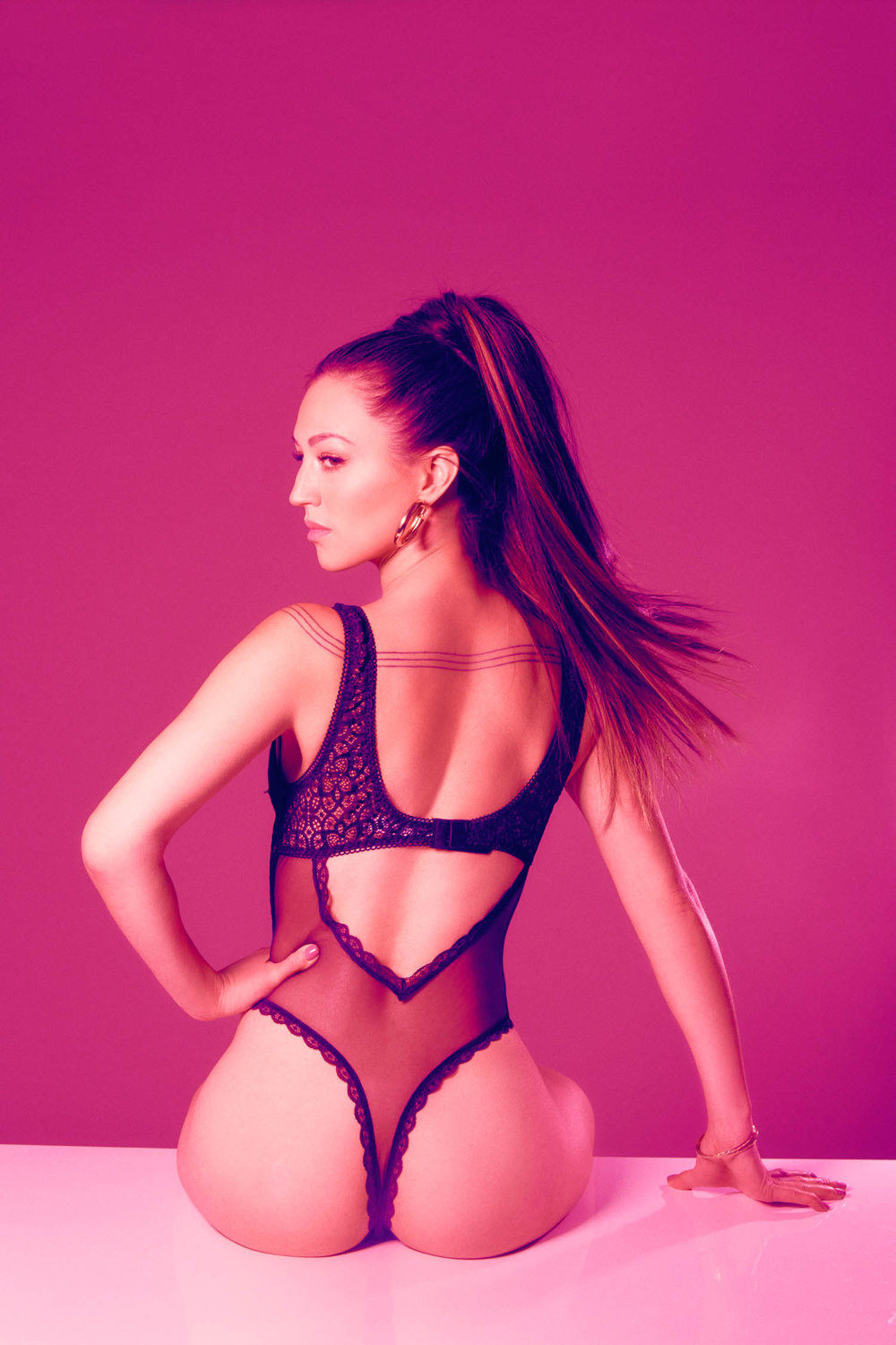 7 Rings boudoir photography with ponytail
