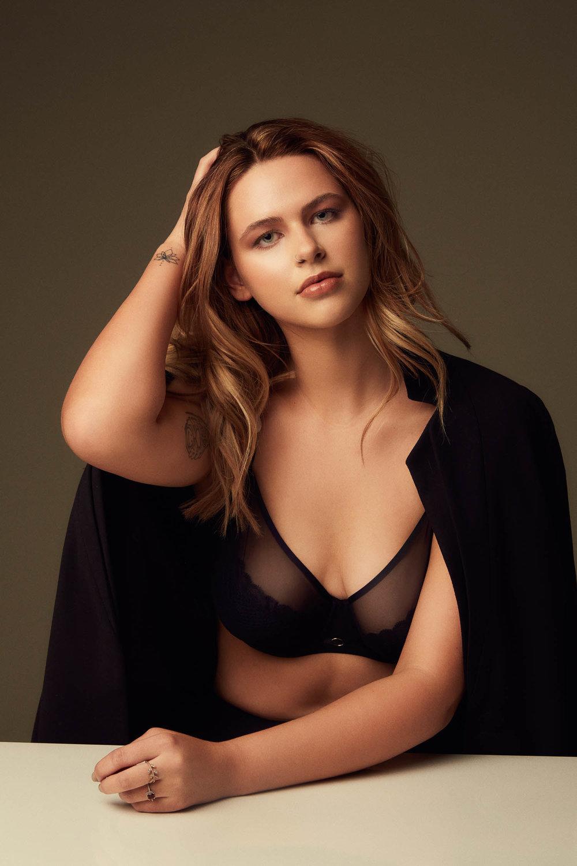 Plus model posing in a black bra set