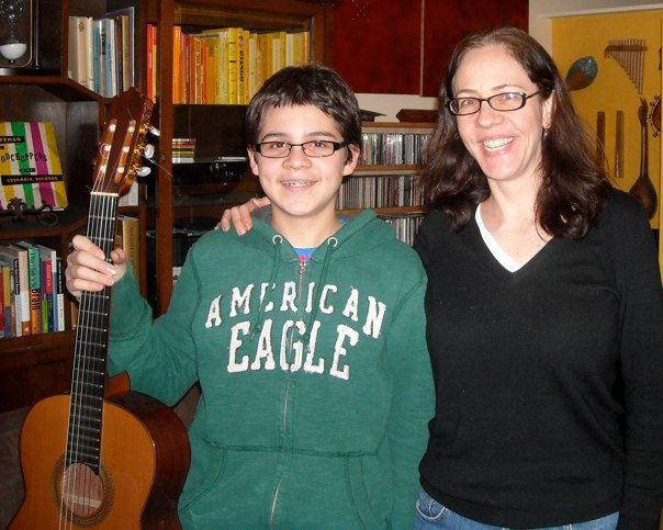 "Alex, age 12, and Jennifer, after he performed ""The Miller's Dance"" by Manuel de Falla and ""Etude No. 1"" by Leo Brouwer at the S.A.M. competition, winning 1st prize, 2008. Alex is currently majoring in chemistry at Lawrence University and still plays classical guitar."