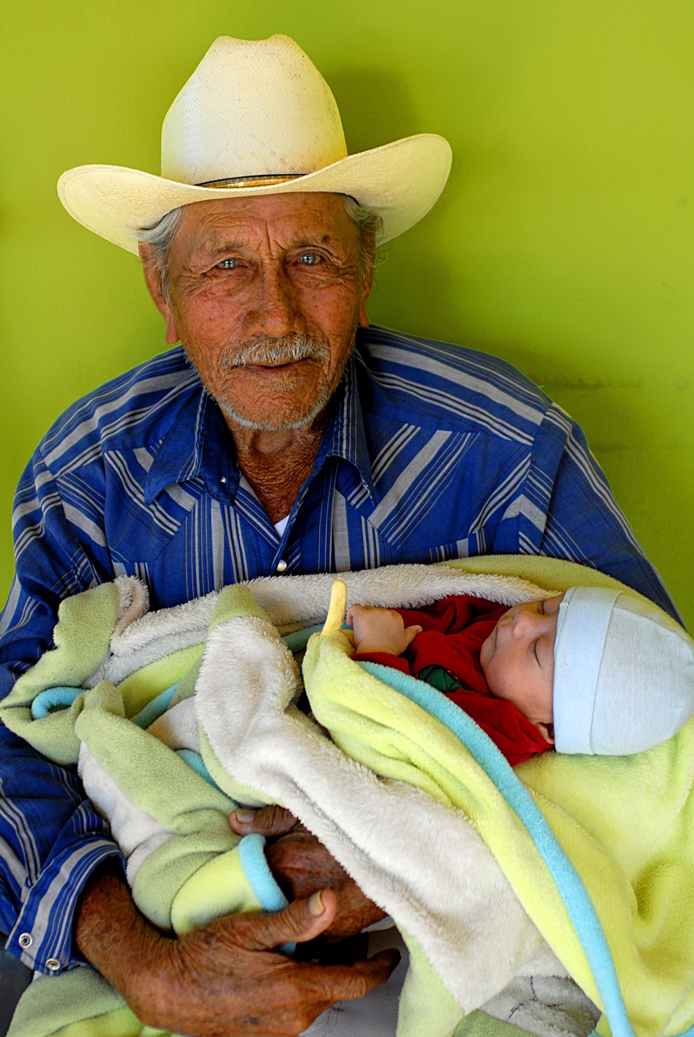 Don Gaston holds his great-grandson, Diego, for the first time. Photo by Rocket Queen Imaging. All rights reserved.