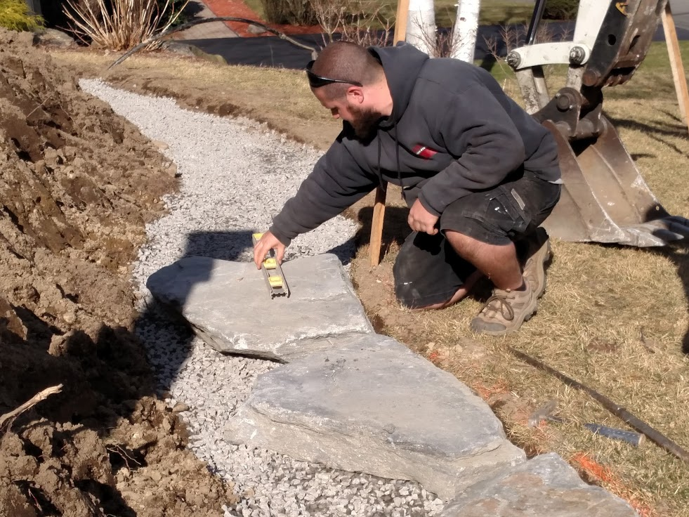J.P. begins laying Goshen stone - a laborious process!