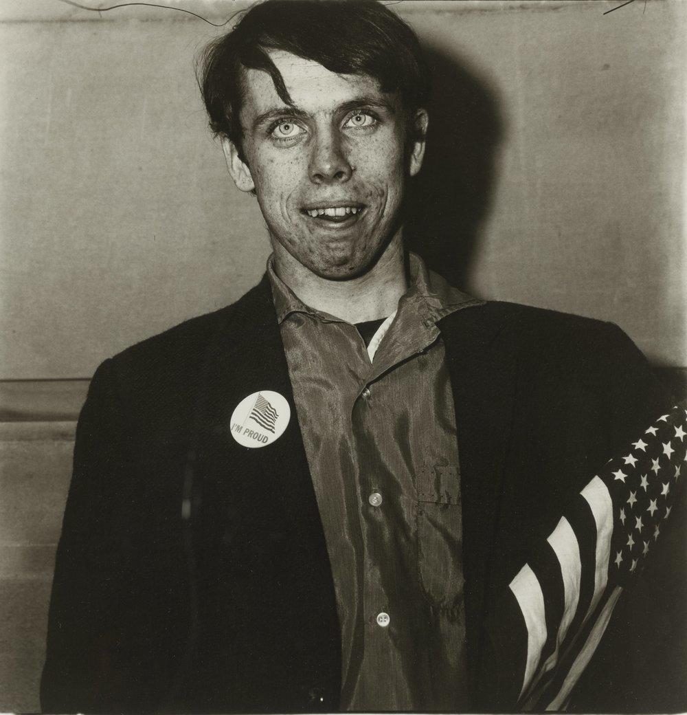 Diane Arbus, Patriotic Young Man with a Flag, N.Y.C, 1967
