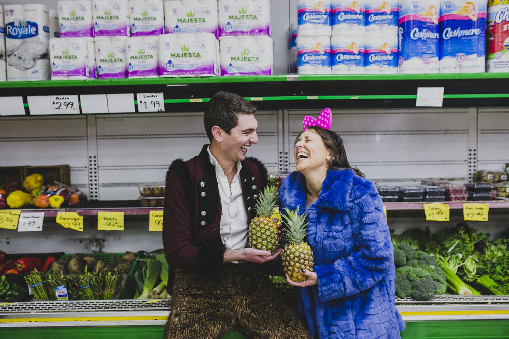Leora & David shopping for pineapples at the local grocery store