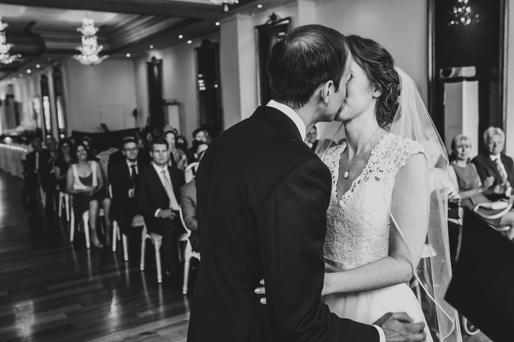 bride and groom kiss during wedding ceremony at rosewater toronto