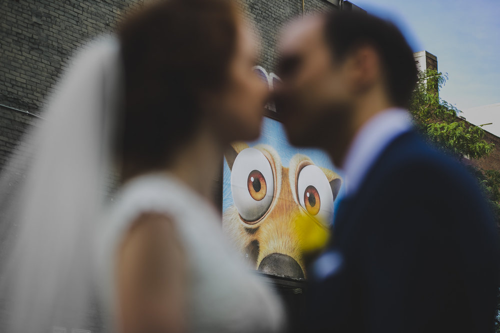 Scrat of Ice Age looking at bride and groom kissing