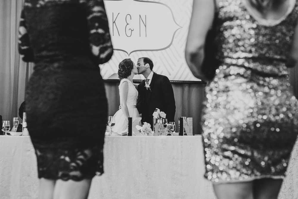 bride and groom kiss during wedding reception at rosewater toronto