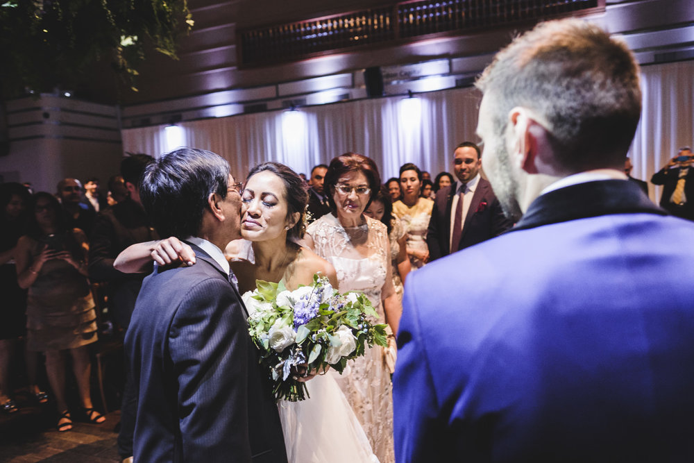 bride kisses her father after precessional