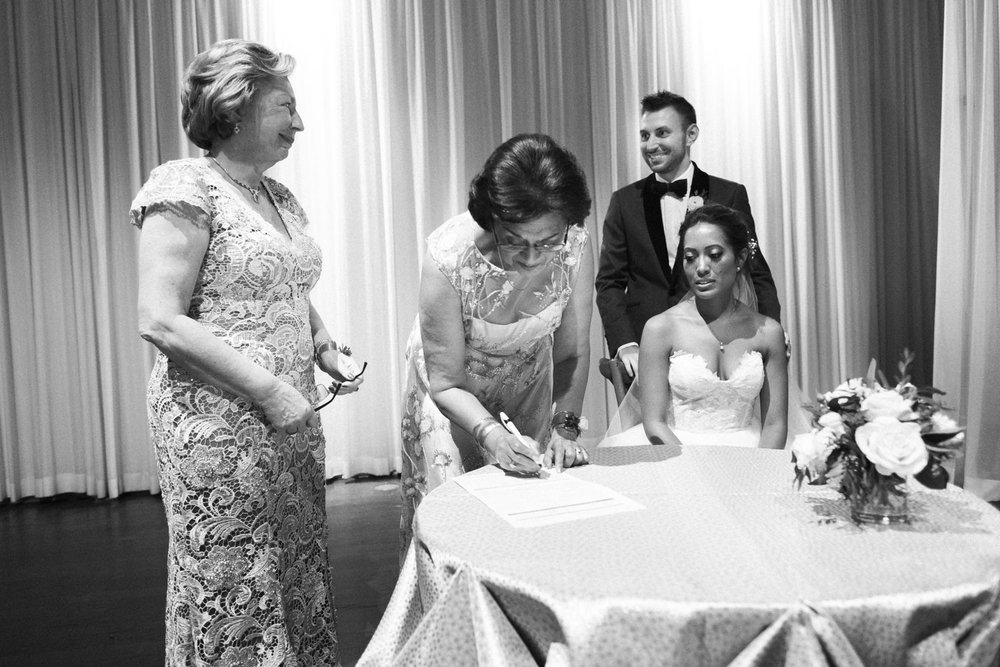 mother of the bride signing marriage certificate