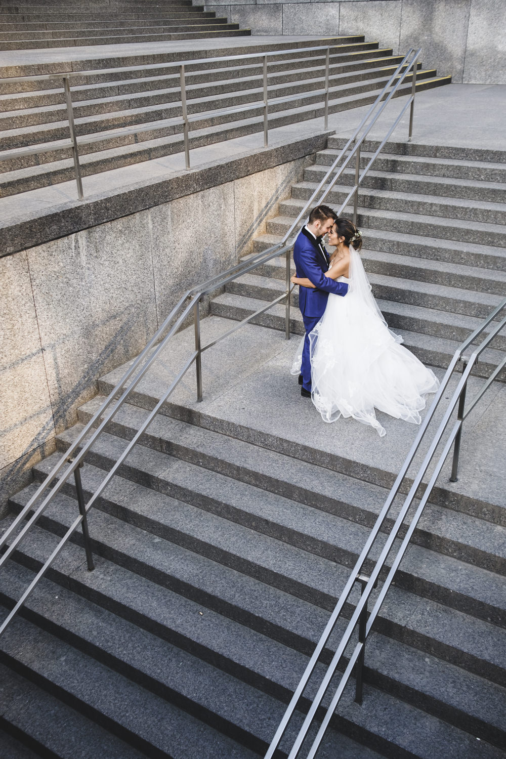 bride and groom portrait on stairs in downtown toronto