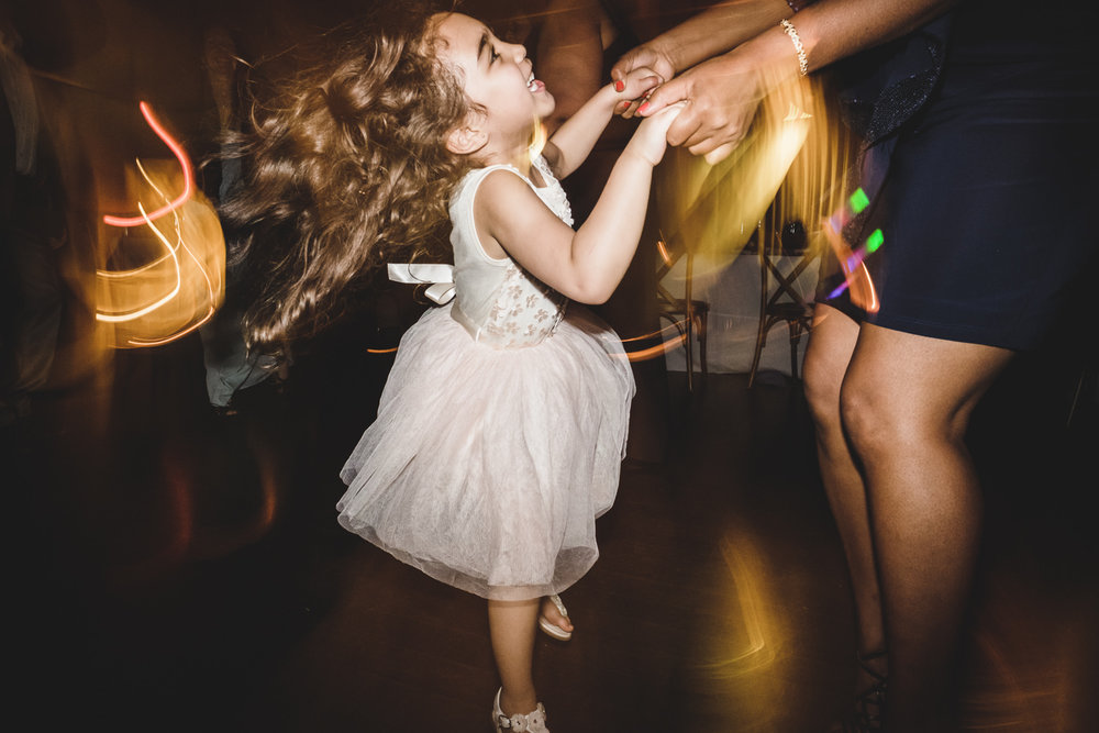 little girl jumps during wedding reception