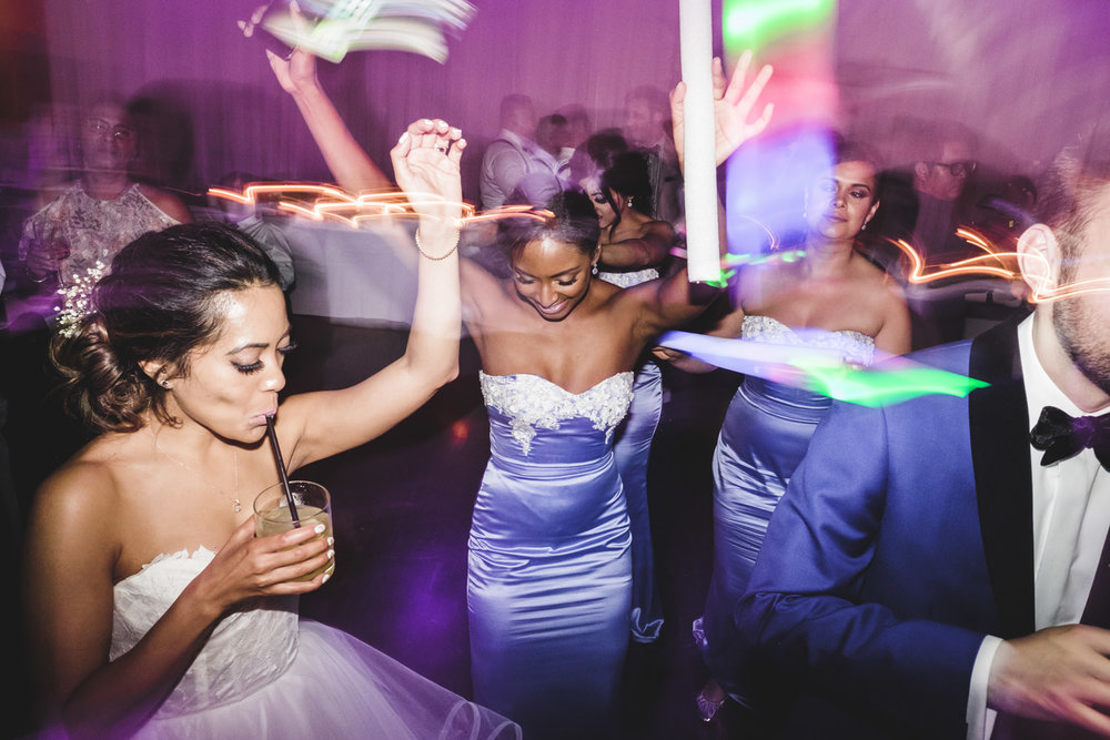 bride dances with guests during wedding reception