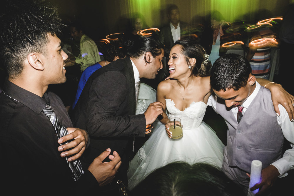 bride celebrates with guests during wedding reception